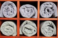 Toallas grises en el armario Imágenes de archivo libres de regalías