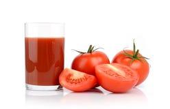 Toamtoes en tomatesap Stock Foto