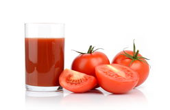 Toamtoes and tomato juice. Few sliced tomatoes and a glass of tomato juice  on white Stock Photo