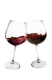 Toast. Two glasses of red wine toasting on white background Royalty Free Stock Photo