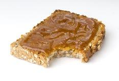 Toast. Rich crispy toast with jam on white background Royalty Free Stock Photo