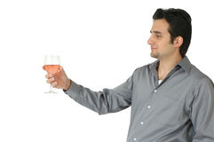 A Toast. Profile of a man raising his glass of wine in a gesture to toast or greet. A host offering a drink Royalty Free Stock Photos