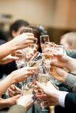 Toast. Many hands with champagne glasses royalty free stock photography