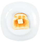 Toast. A slice of toast on a white plate with a square of butter slowly melting on top Stock Photo
