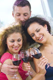 Toast. Portrait of young happy attractive people having some wine Royalty Free Stock Image