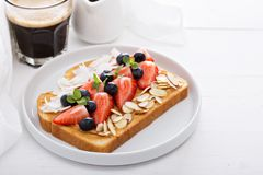 Toast with almond butter and toppings Stock Photos