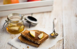 Toast with apple jam. Wooden background Royalty Free Stock Image