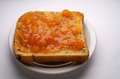 Toast with apricot jam Royalty Free Stock Image