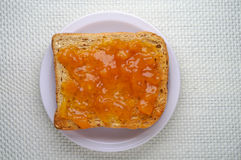 Toast with apricot jam Royalty Free Stock Photos