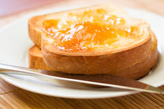 Toast and Apricot Preserves. Thick sliced homemade bread broiled with butter served with apricot preserves stock images