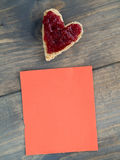 Toast as a heart shape with a red piece of paper Stock Photos