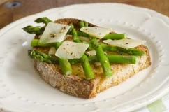 Toast with asparagus Stock Photos