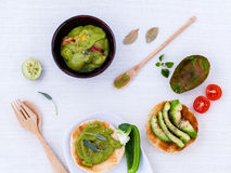 Toast with avocado creamy salad and herbs Stock Photos