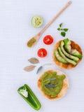 Toast with avocado creamy salad and herbs Stock Photo