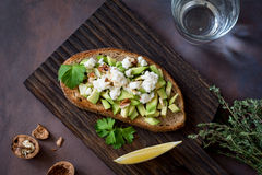 Toast with avocado, feta cheese and walnuts Stock Photos
