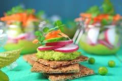 Toast avocado  and  radishes. Toast avocado ,fresh cucumber, radishes and carrots Royalty Free Stock Photo