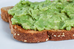 Toast with avocado spread close up Stock Images