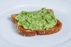 Toast with avocado spread Stock Photos