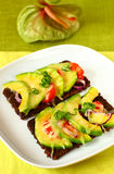 Toast with avocado and tomato Royalty Free Stock Photo
