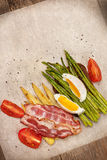 Toast with baked asparagus, boiled egg (top view) Royalty Free Stock Images