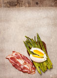 Toast with baked asparagus, boiled egg top view Royalty Free Stock Images