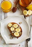 Toast with bananas, peanut butter, nuts and honey Stock Photography