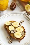 Toast with bananas, peanut butter, nuts and honey Royalty Free Stock Images