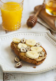 Toast with bananas, peanut butter, nuts and honey Royalty Free Stock Image
