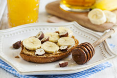 Toast with bananas, peanut butter, nuts and honey Royalty Free Stock Photography