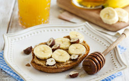 Toast with bananas, peanut butter, nuts and honey Royalty Free Stock Photos