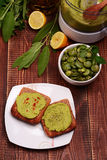 Toast with bean paste and boiled broad beans on wooden background. Royalty Free Stock Photo