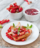 Toast with berries and jam Stock Photography
