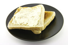 Toast on a Black Plate Stock Photos