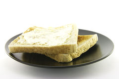 Toast on a Black Plate Stock Images
