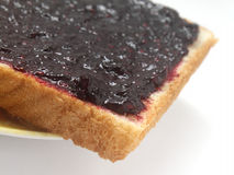 Toast with blackberry jam Stock Images