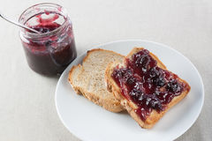 Toast with blueberry jam Stock Photography