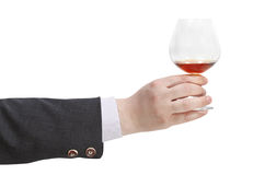 Toast with brandy glass in businessman hand Stock Photography