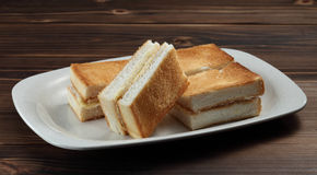 Toast bread. A plate of toast bread with coconut jam and butter Stock Photo