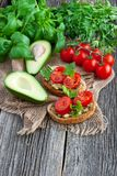 Toast bread and avocado on rustic wooden background. Vegan sandwich with avocado and vegetables on wooden backgroundnn stock photography