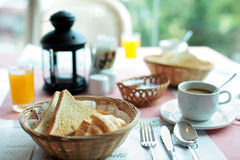 Toast bread in basket with orange jus. On table Royalty Free Stock Image