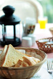 Toast bread. In basket on table Stock Photo