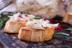 Toast bread with chicken pate on rustic kitchen board Royalty Free Stock Photos