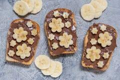 Toast bread with chocolate spread and banana Stock Photos