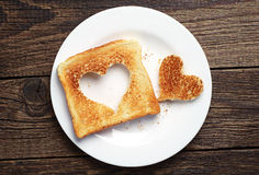 Toast bread with cut out heart shape Royalty Free Stock Image