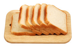 Toast Bread on a Cutting Board. Isolated over white background with clipping-path Stock Photos