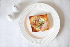 Toast bread, egg and bacon on white background Royalty Free Stock Photos