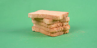 Toast bread on green background Stock Photography