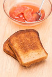 Toast from bread with jam and spoon Stock Photography