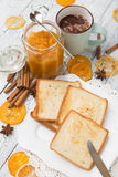 Toast bread with jam on vintage wooden table Stock Images