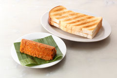 Toast bread with minced fish cake. Two toast bread served with oriental minced spicy fish cake royalty free stock image